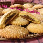 Biscotti di frolla aromatizzati all'arancia con ripieno di Nutella